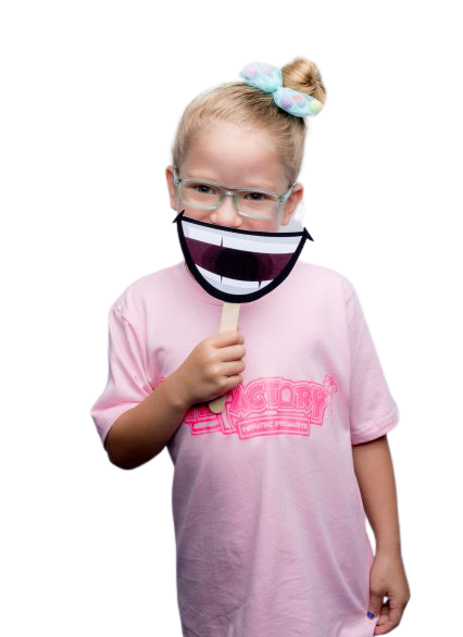 Girl in glasses and pink tshirt holding a smile
